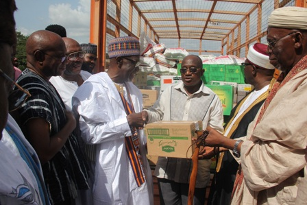 Hon. Simon Osei Mensah in the middle presenting food items to the Leadership of the Muslim community