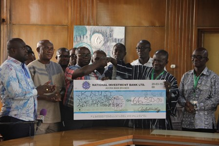 Hon. Osei Assibey Antwi (3rd left), presenting a dummy cheque to Prof. Obiri Danso
