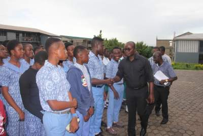 The Kumasi Mayor Mr. Osei Assibey Antwi leading the team to interact with some of the students.