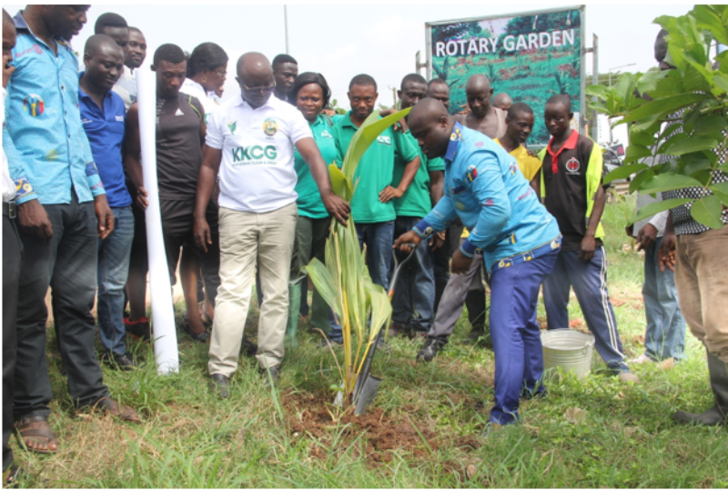 Ing.  Nana Poku Agyeman, President of the Club, assisted by the MCE, planted a symbolic coconut tree seedling at the Gardens.